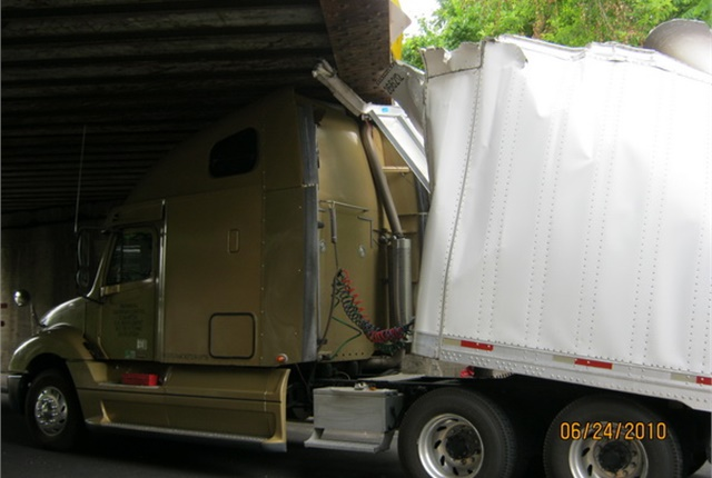 The most common type of vehicle to bash the bridge is a 13-foot, 6-inch-talltractor-trailer, like this one. Damage to the rig far exceeds the $1,000 fine for the infraction. Photo: Delaware Police Dept.