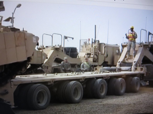 Militaryheavy transport trailer might look menacing to civilians, but it'd do a great job of deterrence.