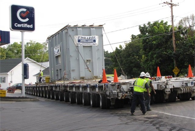 Transporter makes the final swing onto Ohio 37 and, now reversing, begins rolling out of town. The 472,000-pound transformer's destination is a substation several miles to the east.