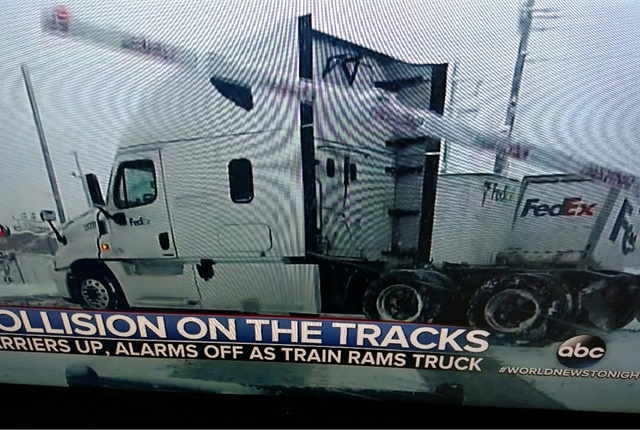 The gates came down after the wreck. And what a mess! Note that the impact yanked the fifth wheel off the tractor's frame. That means the fifth wheel's jaws hung onto the lead trailer's kingpin.