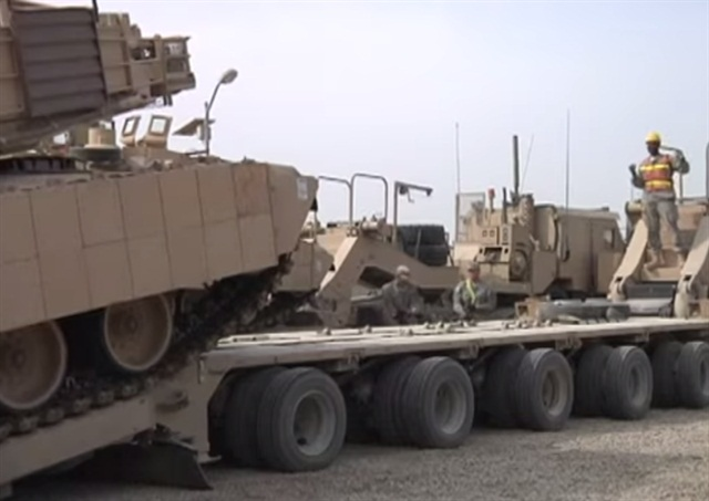 M1000's five axles are mounted along most of its bed length. Loading ramps are part of the trailer's equipment. Photo from U.S. Army via YouTube