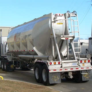 Special fracking sand is just one of the items transported by truck into and out of the shale fields.