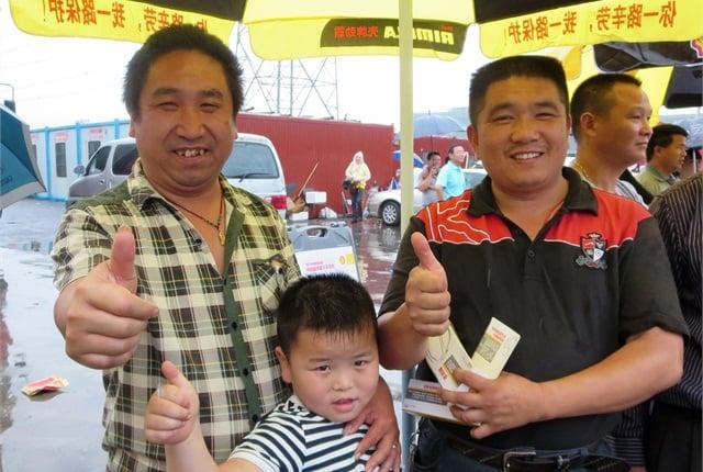 Mr. Wang and Mr. Yu, owner-operators, give the Shell roadshow a thumbs-up. Photo: Deborah Lockridge