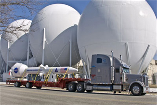 """Trailer Transit hauls """"anything on wheels,"""" from new trailers to this special load for NASA."""