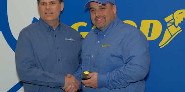 Gary Medalis (left), Goodyear marketing director, congratulates the 2018 Highway Hero Award...