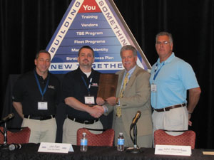 The award was presented by Mark Willis (center right) to Matt Bauer (center left) at the HDA Truck Pride Annual Membership Meeting in San Antonio, Texas. He was joined by Greg Valant (left) and Rick Simon (right) of Keystone Spring, his sponsoring member.