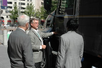 David McKenna, director of powetrain sales and marketing for Mack, explains the company's selective catalytic reduction emissions technology for 2010 to government officials at the Clean Diesel Power event.