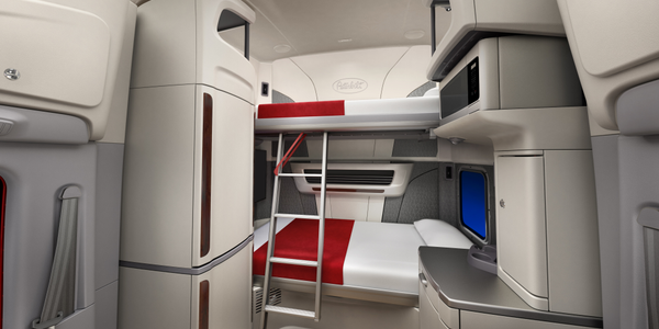 A fold-down ladder offers easy access to the Model 579 UltraLoft's upper sleeper bunk. Photo:...