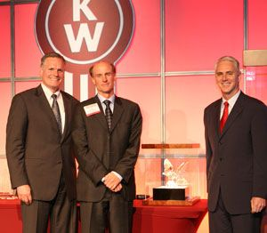 GreatWest Kenworth President Jeff Storwick (center) accepts his award from Bill Kozek (left), Kenworth general manager and Paccar vice president, and Gary Moore (right), Kenworth assistant general manager for marketing and sales.