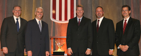 Central Illinois Trucks executives receive their award at the Kenworth Dealer Meeting in Seattle.