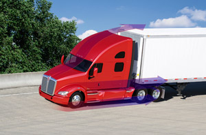 Kenworth's new T700 integrates the hood, bumper, fenders, headlamps, fairings, windshield and roof in a precise, clean manner for the resulting fuel-efficient and stylish shape.