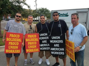 Union members protest the loss of handling military cargo at the Port of Charleston, S.C. A lack of a contract could drive shippers away from East and Gulf Coast ports, warn retailers.