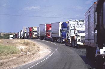 Trucks line up near the border in Laredo, Texas.