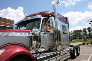 OEConnection President and CEO Charles Rotuno sits in a new 2009 International LoneStar truck.
