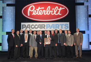 Peterbilt of Sioux City Accepts the 2011 Parts and Service Dealer of the Year Award