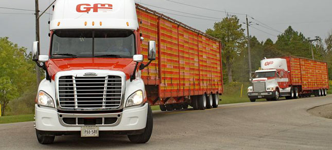 The House T&I Committee killed a provision in the highway bill that would have allowed 97,000-pound rigs in six-axle configurations, similar to these Canadian trucks. (Photo by Jim Park)