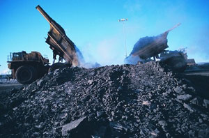 Lower crude oil prices have made oil sand mining, like this Suncor operation, less profitable.