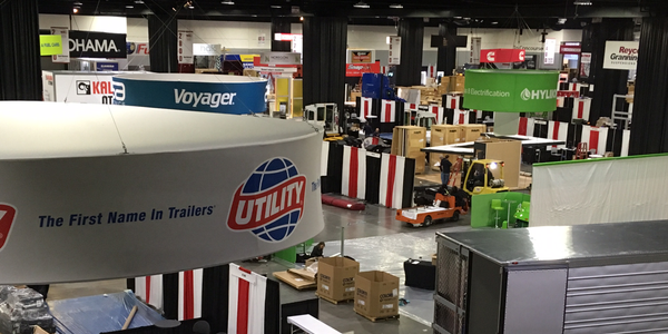 The TMC exhibit hall show floor takes shape Sunday. Photo: Jim Park