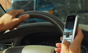 Drivers caught texting while driving in Massachusetts now face penalties. (Photo by Jim Park)