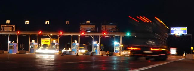 Toll booths and even transponder-based billing could become obsolete if GPS-based tolling catches on. Photo by Jim Park.