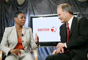 Xerox CEO Ursula Burns (left) and ACS President and CEO Lynn Blodgett (right) discuss Xerox's acquisition of ACS.