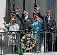 Waving from the White House balcony, President Bush welcomes Mexican President Vicente Fox Sept. 6.