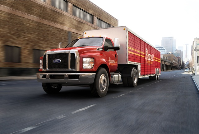 Like trucks, a dedicated tractor model will have a mesh grille and sculpted fender lines as part of new styling. New USA-built models are due out in spring of 2015.