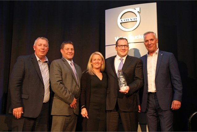 S&S Volvo dealer principal Todd Schaub (right of center) and wife Lynn Schaub (center) receive the award for the 2017 Volvo Trucks North American Dealer of the Year from (left to right) Bruce Kurtt, senior vice president of sales for Volvo Trucks North America, Chris Gossler, regional vice president northeast U.S. region and Göran Nyberg, president of Volvo Trucks North America. Photo: Volvo