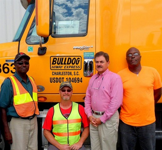 With Phil Byrd, president of Bulldog Hiway Express (second from right) are senior drivers (left to right), Robert Gibbs, Timothy Smith,and Gerald Waring. Photo courtesy of Bulldog Hiway Express