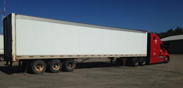 A House bill would let states set a 91,000-pound weight limit on highway rigs fitted with a sixth axle, similar to this truck built for operation in Maine.
