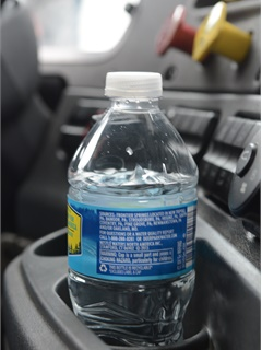 Tire and wheel vibration makes the water in this bottle dance around. This was the non-balanced truck.  Photo by Jim Park