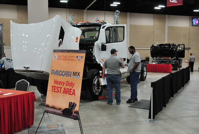 A contestent and an official discuss a problem at the Rush Truck Centers 10th annual Tech Skills Rodeo in San Antonio. Photo by Jim Park