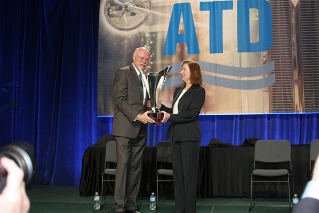 ATD Senior Director Barbara Robinson presents the trophy for the 2017 Truck Dealer of the Year to winner Robert Nuss. Photo: Bob Brown