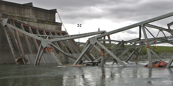 A tractor-trailer with an over-height load struck multiple overhead braces on the Skagit River...