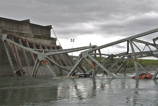 A tractor-trailer with an over-height load struck multiple overhead braces on the Skagit River bridge, causing it to collapse.  - Photo: NTSB