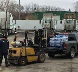 Unloading donations of bottled water at Jet Express to be shipped to Flint, Mich. Photo courtesy Jet Express.
