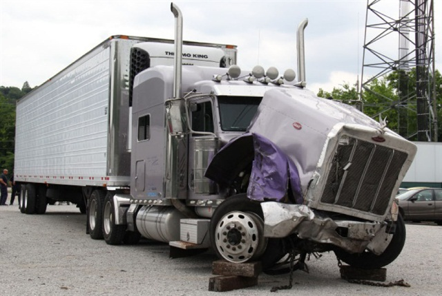 The NTSB preliminary report shows the damage to Brewer's vehicle following the crash.