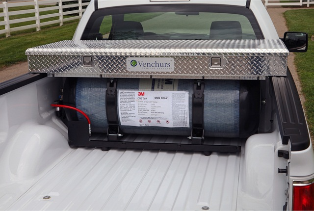 Storage tank for CNG or propane is bolted to the bed, while special fuel lines and injectors complete the package. Venchurs is among Ford's approved modifiers.