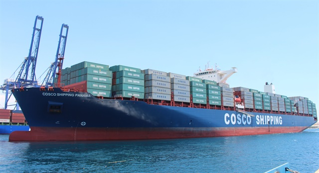 The container vessel COSCO Shipping Panama made the inaugural transit of the expanded Panama Canal on Sunday, June 26, after a 14-day journey. It has a container carrying capacity of 9,472 TEUs. Photo: Panama Canal