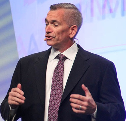 David Wangler, president TMW Systems, welcomes attendees to the company's user conference Sept. 14. Photo by Jim Beach