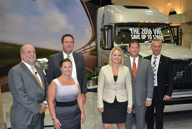 (L-R): Mike Cain, Michelin vice president of original equipment; Mark Seymour, president of Kriska Holdings; Denise Elliot, safety manager, Kriska Holdings; Senta Brookshire, director of safety and driver development, Britton Transport; Jim Stockeland, president of Britton Transport; and Gӧran Nyberg, president of Volvo Trucks North American sales and marketing. Photo by Stephane Babcock