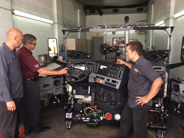Technicians check out the new Cascadia Simulator (image courtesy of Fyda Freightliner)