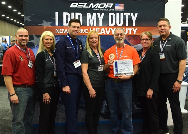 Larry Berman and his wife Mary accept a certificate for winning the I Did My Duty... Now I Drive Heavy Duty contest. Photo: Darran Zancan, DMZ Productions