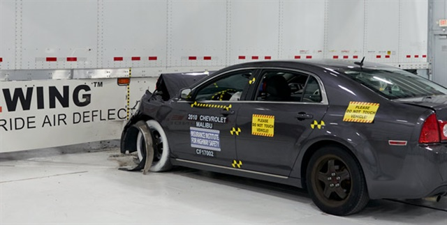 IIHS said a crash test showed that an AngelWing side underride guard stopped a car from going underneath the trailer. Photo: IIHS