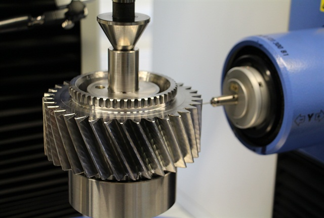 Officials at Daimler's Gaggenau transmission manufacturing facility emphasized the numerous quality checks on the product, including this test of a transmission gear. (Photo by Evan Lockridge)