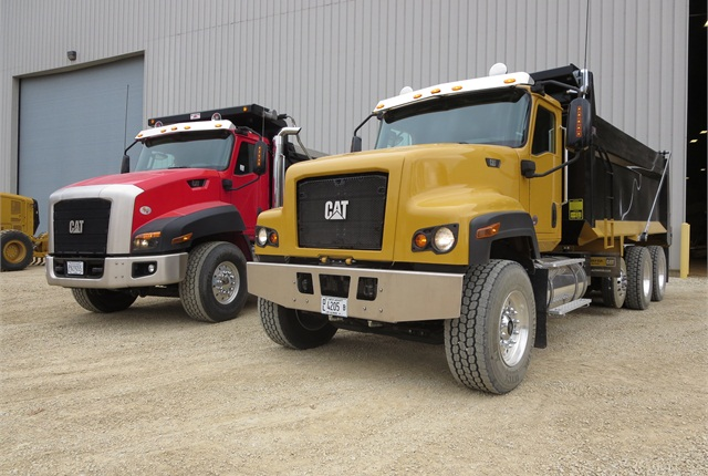 Cat CT660 (left) and CT681 vocational trucks are based on Navistar's International PayStar, and built in Escobedo, Mexico. Photo by Tom Berg