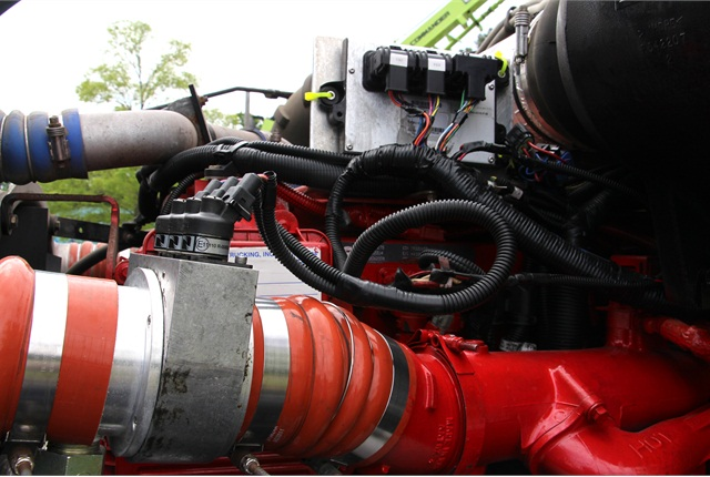 Parts from NGV Systems' diesel/natural gas hybrid retrofit kit on a Cummins ISX engine powering a KW T-2000.