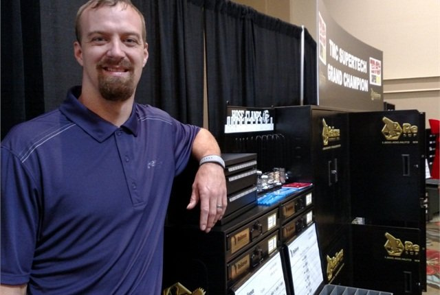 Eric Vos, 31, wonTMC SuperTech's grand championship in testing this week near Orlando. He's standing with some of his tool prizes.