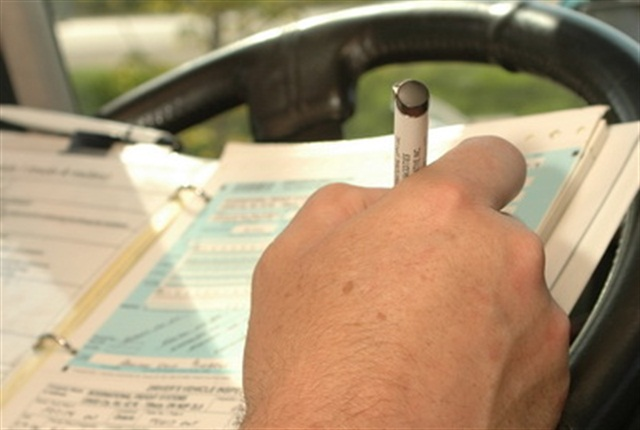 One trucking group says the way to end the controversy is to go ahead and end the use of paper logbooks. Photo: Jim Park