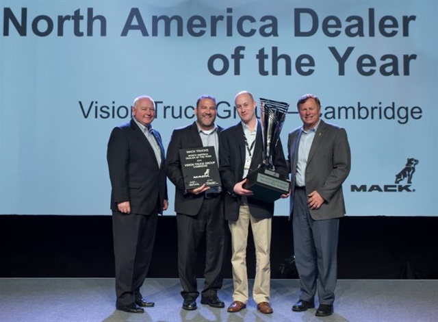 John Slotegraaf, president of Vision Truck Group (center right), accepts the award from Dayle Wetherell, Mack regional vice president, Canada (left), Jonathan Randall, senior vice president of sales, Mack Trucks North America (center left), and Dennis Slagle, president, Mack Trucks (right). Photo: Mack Trucks